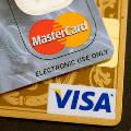 Российские власти смягчили технические требования к Visa и MasterCard